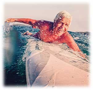 A 100 year old man surfing
